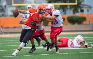 LP Quarterback #9 tries to shed a tackle by Plymouth #33 Friday nght