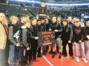 Members of Pomona's wrestling team pose after being presented the Class 5A state wrestling championship trophy Feb. 18 at Pepsi Center. The Panthers claimed their fifth team title since 2000 and also won four individual titles on the final day of the 3-day state tournament.