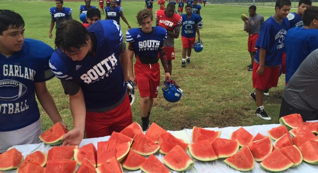 Colonel football team enjoys watermelon after practice