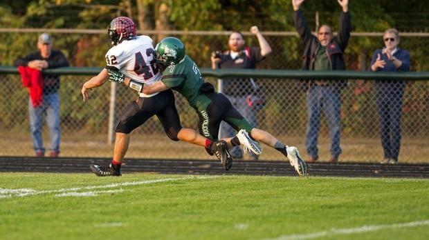 Addison High School Varsity Football beat Napoleon Pirates 32-30