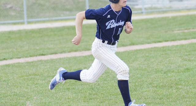 Petoskey splits with Trojans in home openers