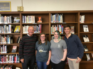 Rudy Kalis (left) visited CMS to talk archery with Alison Blanton, Kayleigh Corban and Connor Smathers