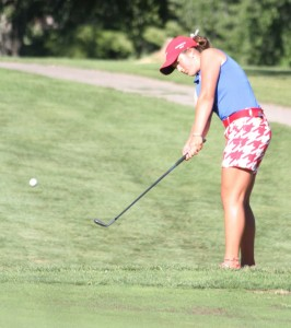 Martinsville sophomore Emmah Keller chips on to the green at Foxcliff Golf Course during Monday's match against Center Grove. Photo by Melissa Dillon.
