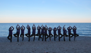 The team shows off their yoga skills at Grant Park on October 19th, 2017.