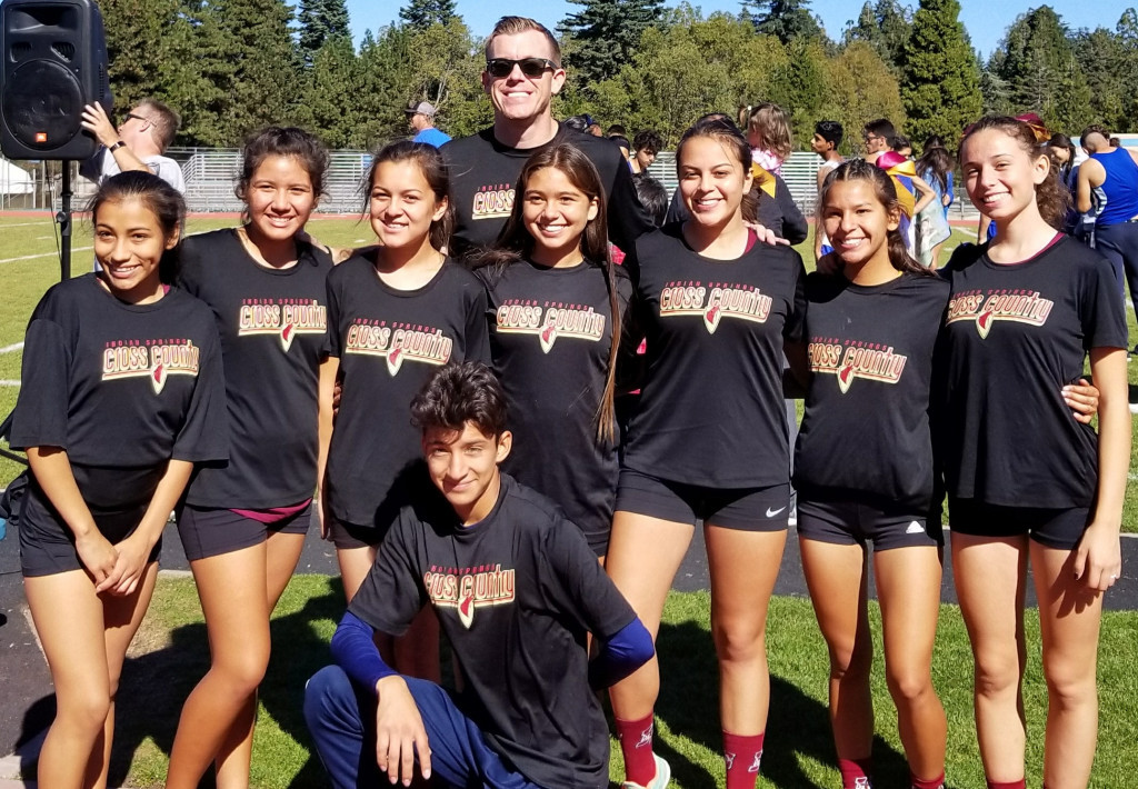 Coach Browning with the varsity girls and Fernando Rojas