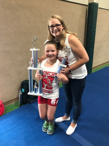 Coach Sandy with daughter Lillian excited for the trophies