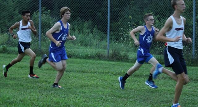 Knight Runners Dominate Home Opener