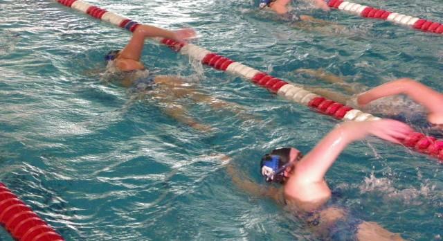 Varsity Swim & Dive battles hard against State Ranked Cranbrook.