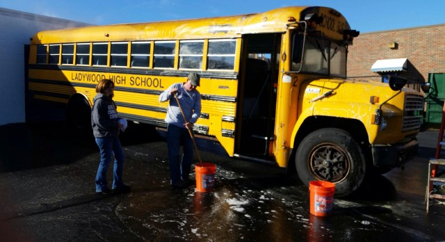 Parent Volunteers give Bus some much needed TLC.