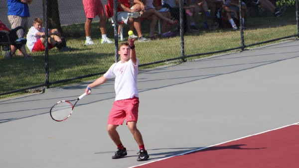 At No. 3 singles, senior Blake Winchell prepares to launch his serve.