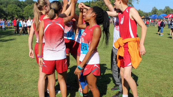 The girls and boys cross country team finish their pep talk before the race. Both teams will compete for the Conference title on Saturday. photo by Taylor Wooten