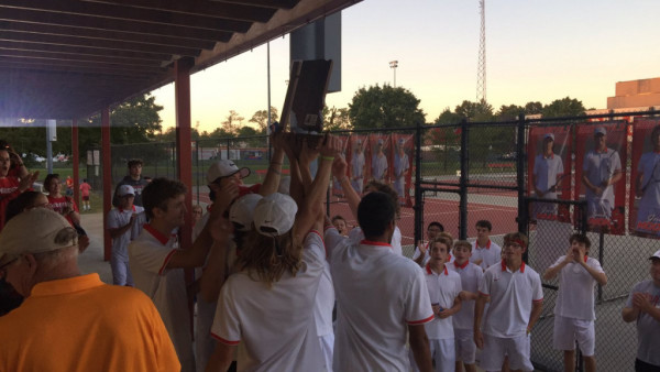 The JHS boys tennis team hoists their Sectional trophy following a 3-2 win over Providence on Thursday,