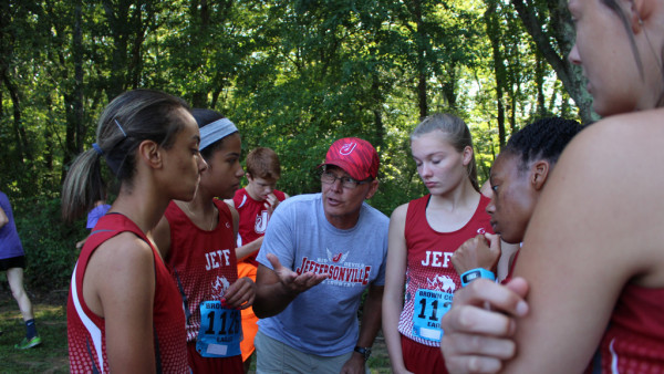 Head coach Mark Felix talks up his young girls cross country team.