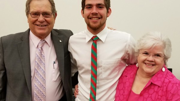 National Merit Scholar Semi-finalist James Brandon (center) with grandparents, Don (left) and Janet (right) Brandon.