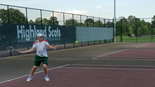 Austin Mote returns volley during his dominating 6-0, 6-0 performance vs Muncie Burris