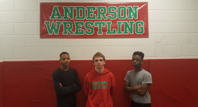 Three Varsity Wrestlers Advance to Regionals