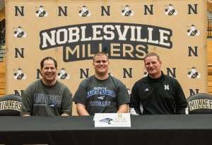 Pictured (L to R): Front Row: Jeff Dreyer, Austin Dreyer, Noblesville Head Football Coach Jason Simmons.