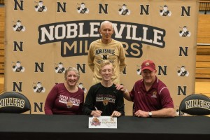 Pictured (L to R): Front Row: Linda Hoffman, Eric Hoffman, Todd Hoffman. Back Row: Noblesville Head Boys Cross Country and Track & Field Coach Kent Graham.