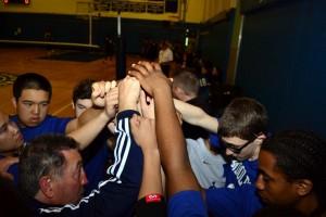 boys vball team huddle