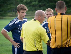 Senior Captains Clay Troyer and Trey Kapsalis confer with the referees.