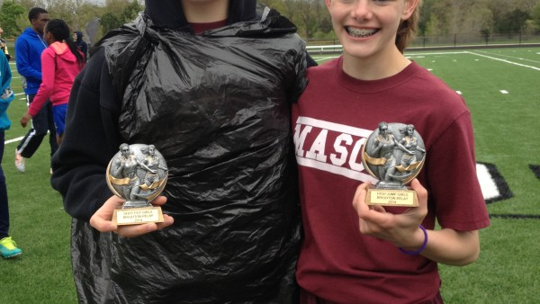 Olivia O'Brien (shot put) and MacKenzie Cortese (high jump) show off their first place trophies.