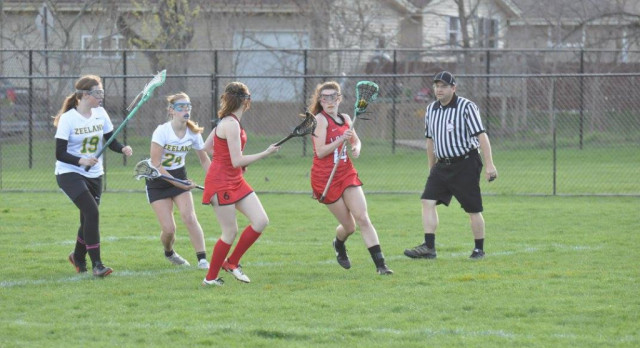 Lowell High School Girls Varsity Lacrosse beat Zeeland East High School 8-7