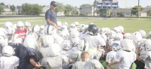 Hawk players help put campers through their football paces