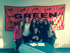 Paige Darnell-Smith surrounded by her friends at her signing.