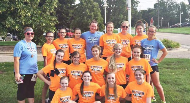 Sideline Cheer: Volunteering at Strides for Health 5K