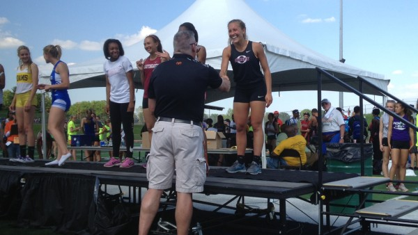 Okemos Ashlynn Schiro accepts her state championship medal in the 300m hurdle award ceremony.