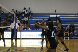 Senior captain, C. Simon gets ready to set up A. McMiller for the spike.