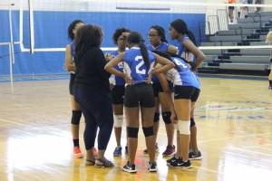 Coach Parker gives the girls a pep-talk to help lift their spirits.