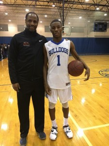 Senior point-guard, Berlin Roberson (BJ) with his coach, Dr. Muhammad, in a celebratory picture marking 1,000 points scored for BJ.