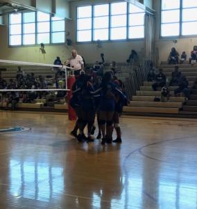 Varsity team encouraging each other.