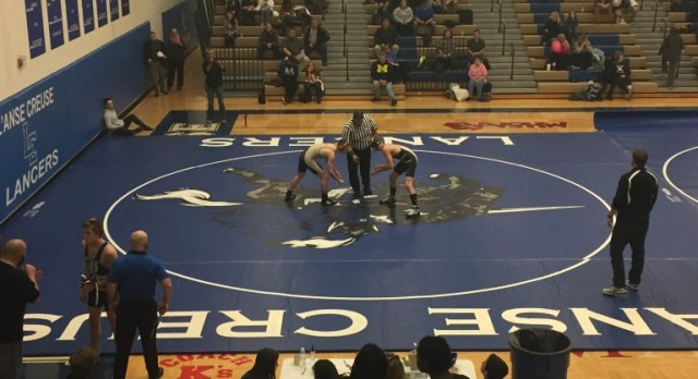 Lancers Excite in Wrestling Home Opener