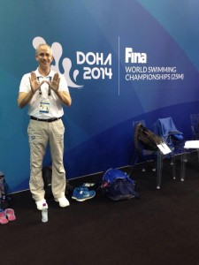 Longtime Swimming & Softball Parent Jeff Raker shows his W officiating the World Short Course Swim Championships