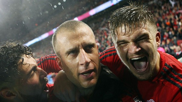 TORONTO, ON - NOVEMBER 30:  Benoit Cheyrou #8 (C) of Toronto FC celebrates a goal with Jonathan Osorio #21 (L) and Nick Hagglund #6 (R) during the second half of the MLS Eastern Conference Final, Leg 2 game against Montreal Impact at BMO Field on November 30, 2016 in Toronto, Ontario, Canada.  (Photo by Vaughn Ridley/Getty Images)