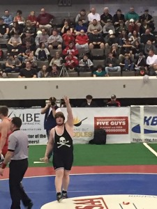 Gavin Jackson walks off the mat victorious