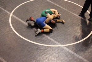 Ethan Ladyman overtakes his opponent as he tries to win the match with a pin.