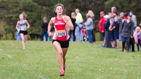 Sprinting at the finish, senior Clara Godoy-Henderson has a top-20 finish in the 5km race