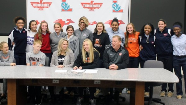 Coach Katie Krieg and members of the Girls Basketball team surround Madison Stolly and family following her Letter of intent signing at LCC (Photo Courtesy of LCC)