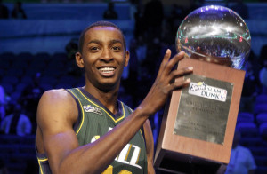 Utah Jazz Jeremy Evans holds the trophy after winning the slam dunk contest during the NBA All-Star weekend in Orlando, Florida, February 25, 2012.   REUTERS/Jeff Haynes (UNITED STATES  - Tags: SPORT BASKETBALL)