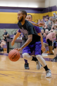 Jon Hall '11 dribbles toward the hoop