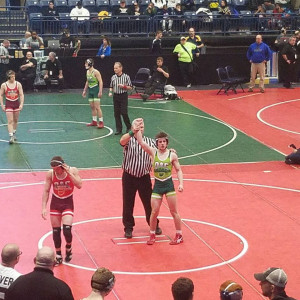 Austin Pownall has his hand raised in victory in the State Finals.