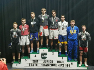 Nate Amato on the podium at the OAC Junior High State Tournament.