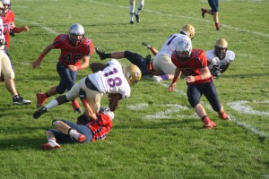 The Pats swarm and bring down a New Haven ball carrier. Photo by Savannah Head