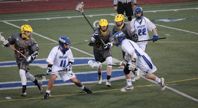 Oxford High School Boys Varsity Lacrosse beat L'Anse Creuse High School 7-6