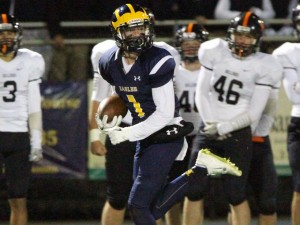 After intercepting a pass intended for Brighton, Hartland's Brett Borseth turns and sprints to a touchdown, putting Hartland ahead 14-7 Friday night at Hartland.  Alan Ward/Livingston Daily