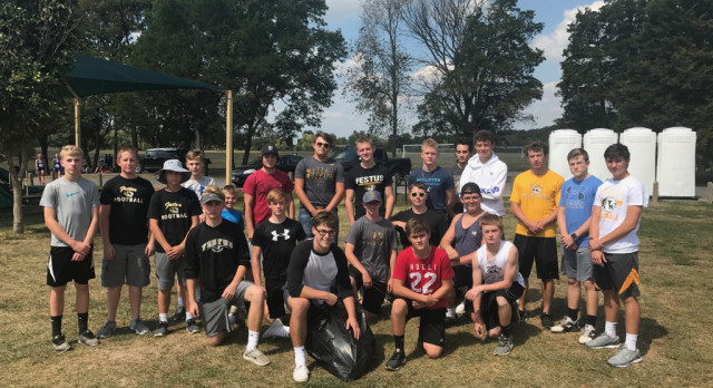 Football Tigers Help With Clean Up After Bowles Invitational