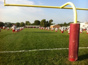 The New Palestine football team prepares for its scrimmage against Scecina on Friday.
